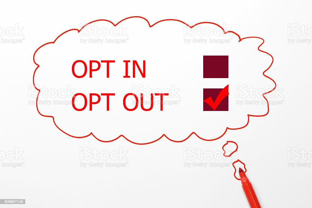 writing opt in and out, red marker on talking bubble stock photo