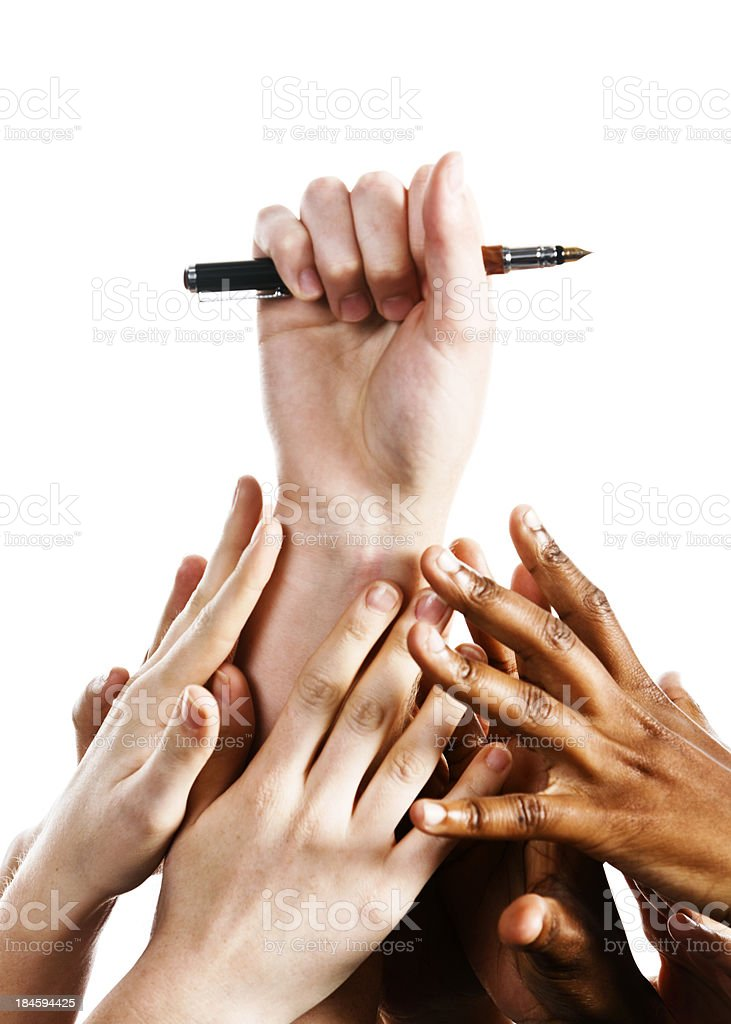 Writing rules; many hands compete for fountain pen royalty-free stock photo