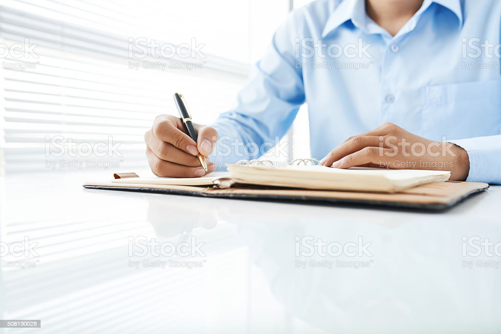 Writing student stock photo