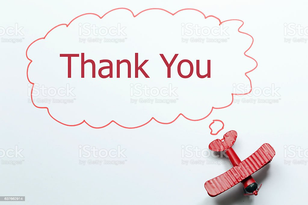 writing thank you red toy airplane with talk bubble stock photo