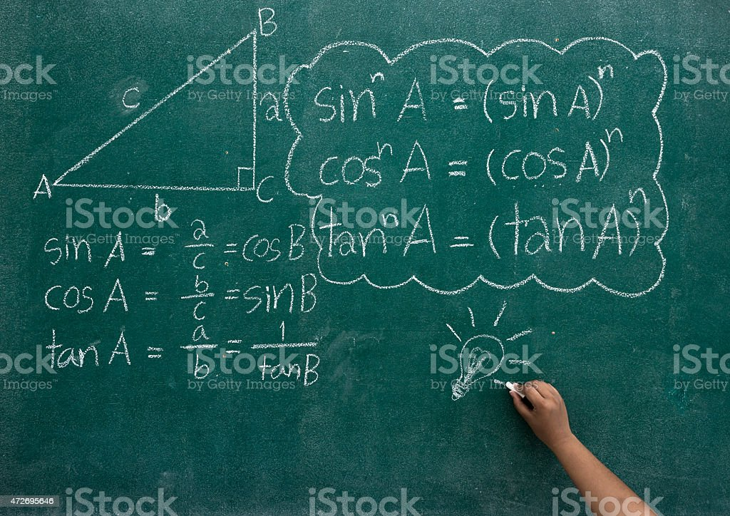 Writing the mathematics formulas on a blackboard stock photo