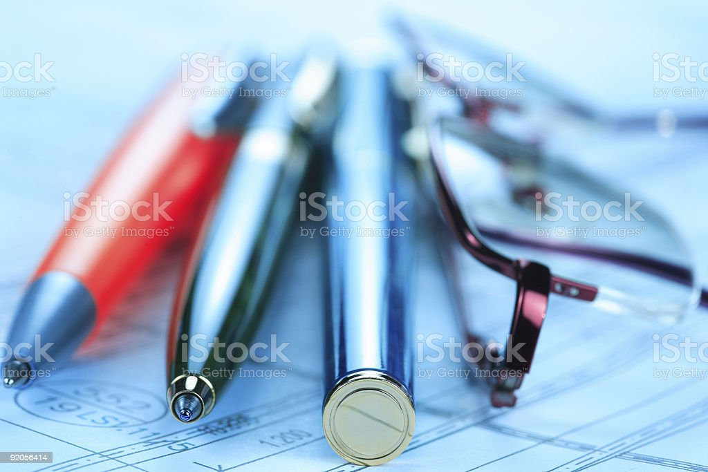 Writing Tools and Eyeglases in Blue royalty-free stock photo