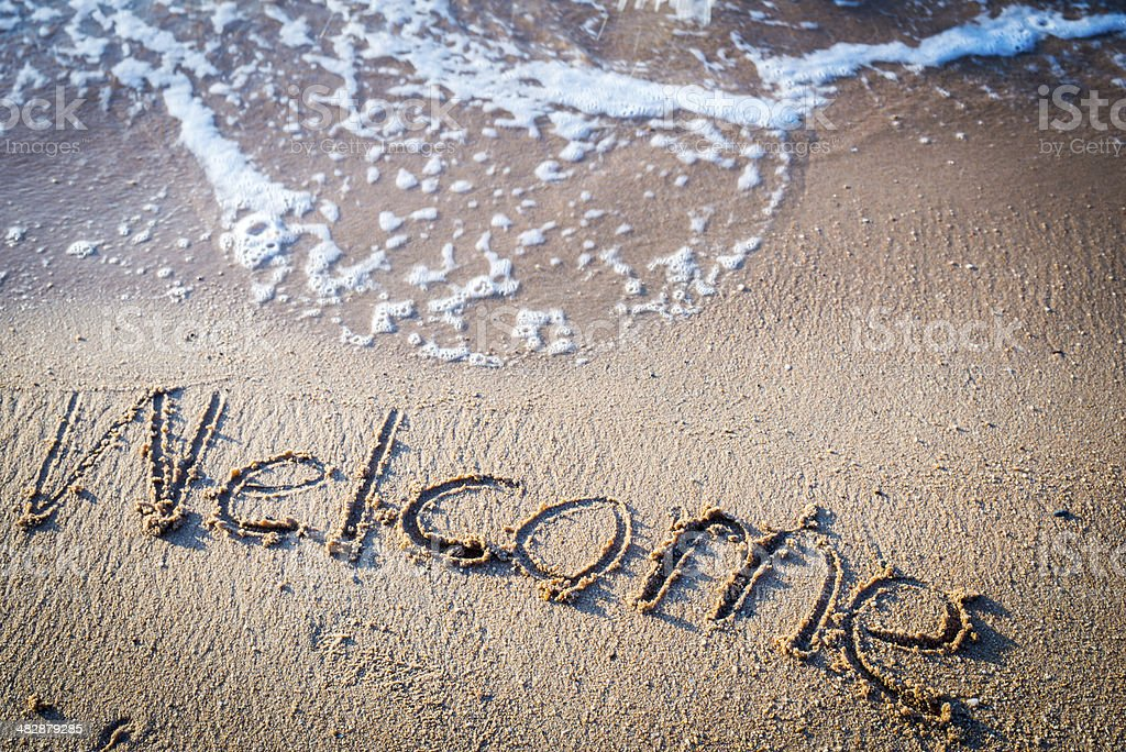 Writing Welcome on the Beach in Thailand royalty-free stock photo