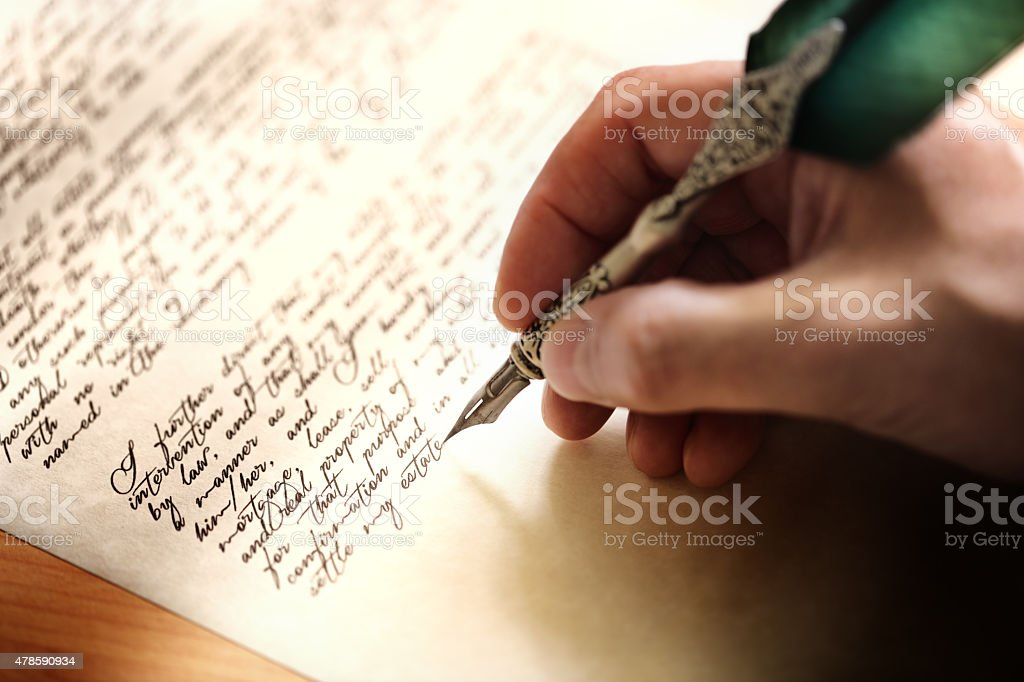 Writing with quill pen stock photo