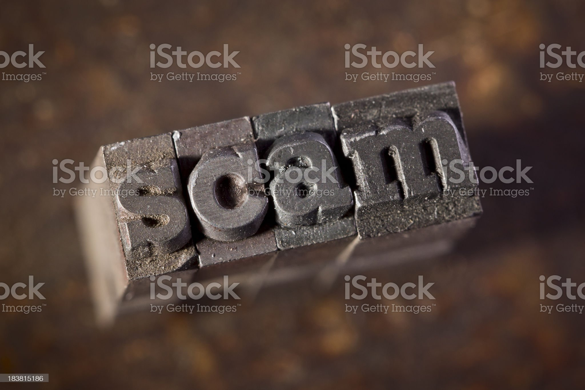 SCAM written in old letterpress against wood background royalty-free stock photo