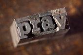 PRAY Written In Old Typeset