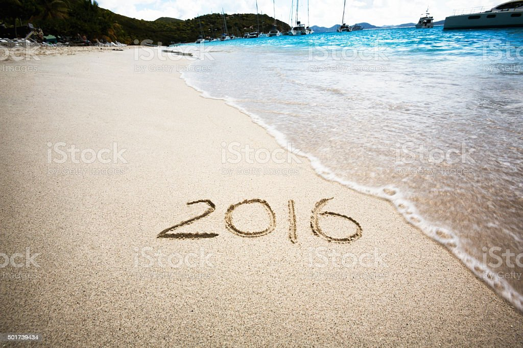 2016 Written in Sand on Sunny Tropical Beach stock photo