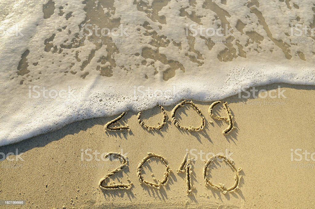 2009-2010 Written in the Sand with a Wave royalty-free stock photo