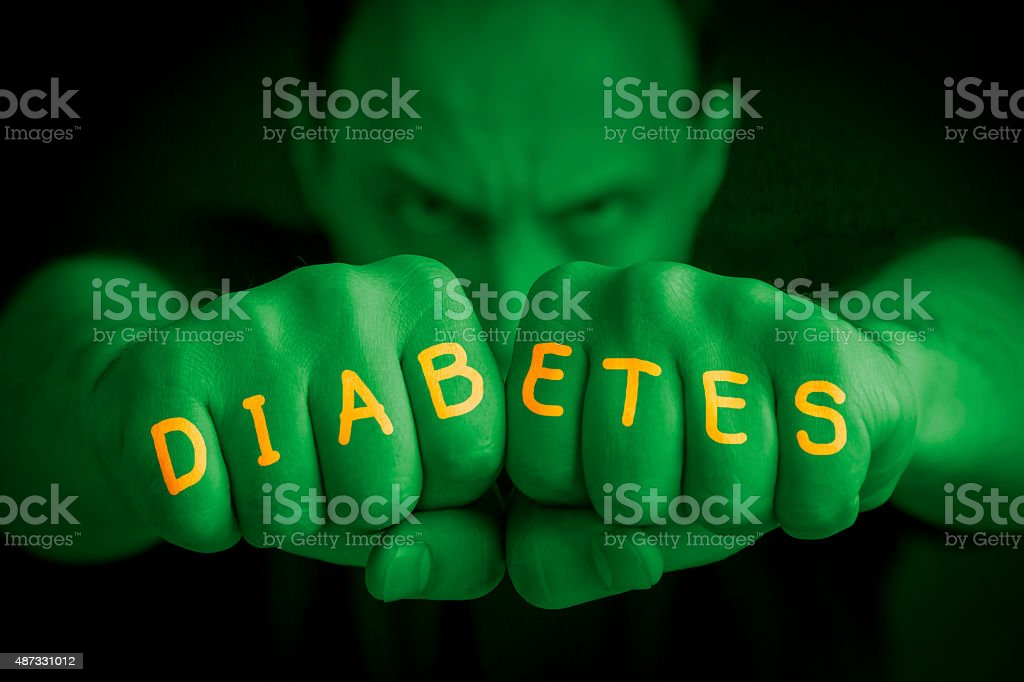 DIABETES written on an angry man fists royalty-free stock photo