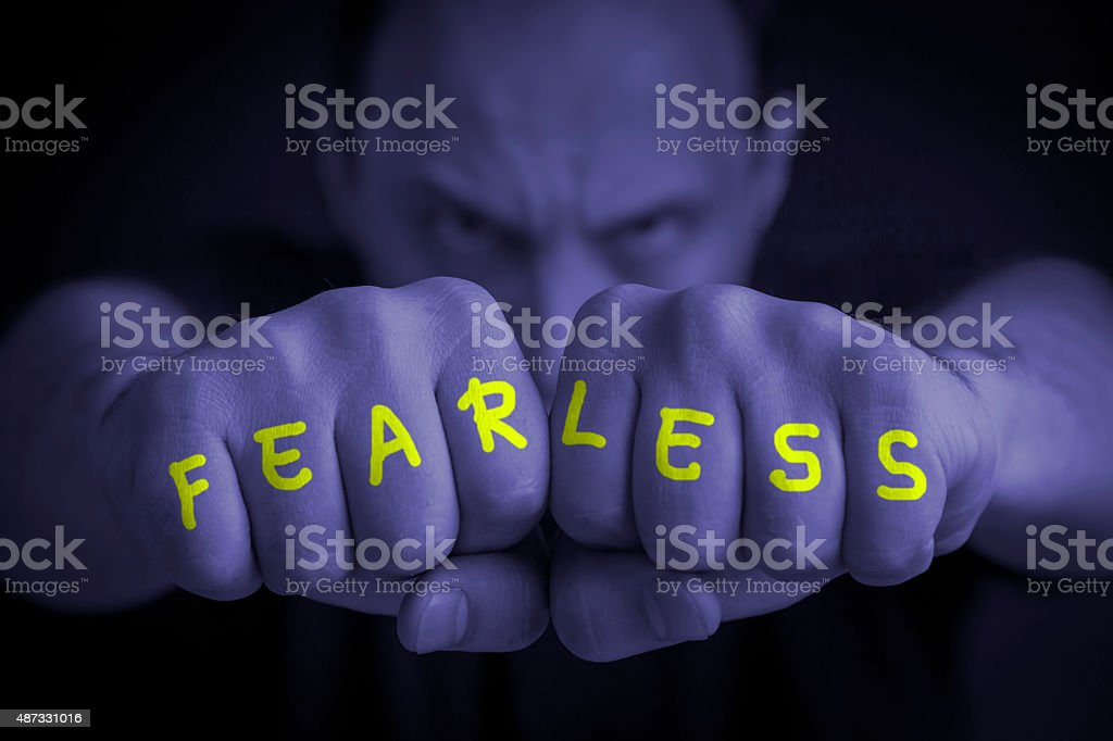 FEARLESS written on an angry man fists royalty-free stock photo