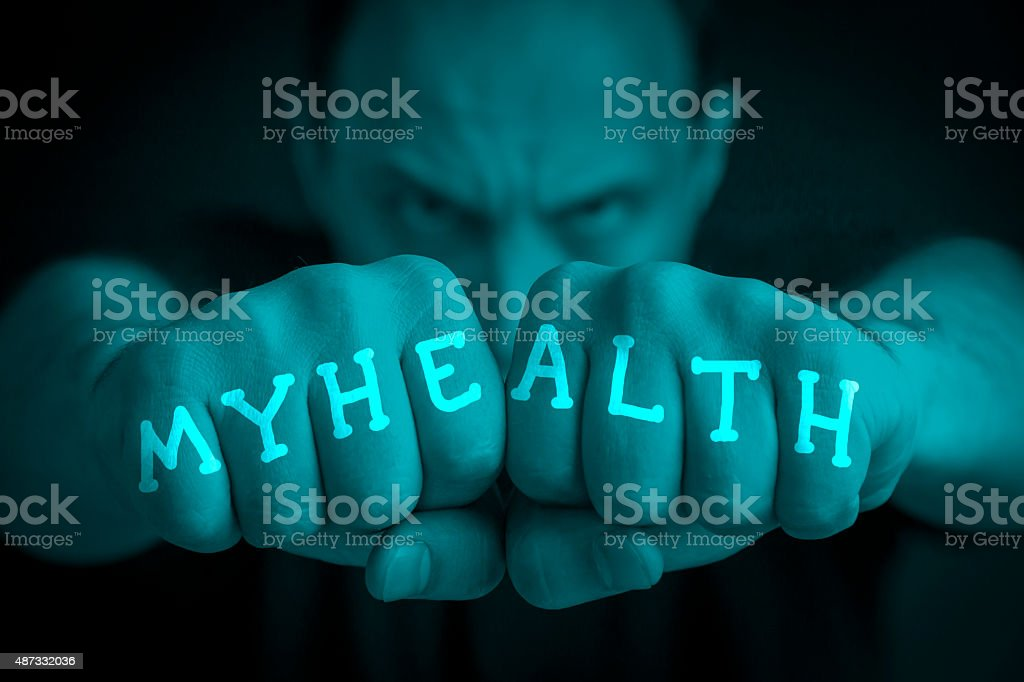 MY HEALTH written on an angry man fists royalty-free stock photo