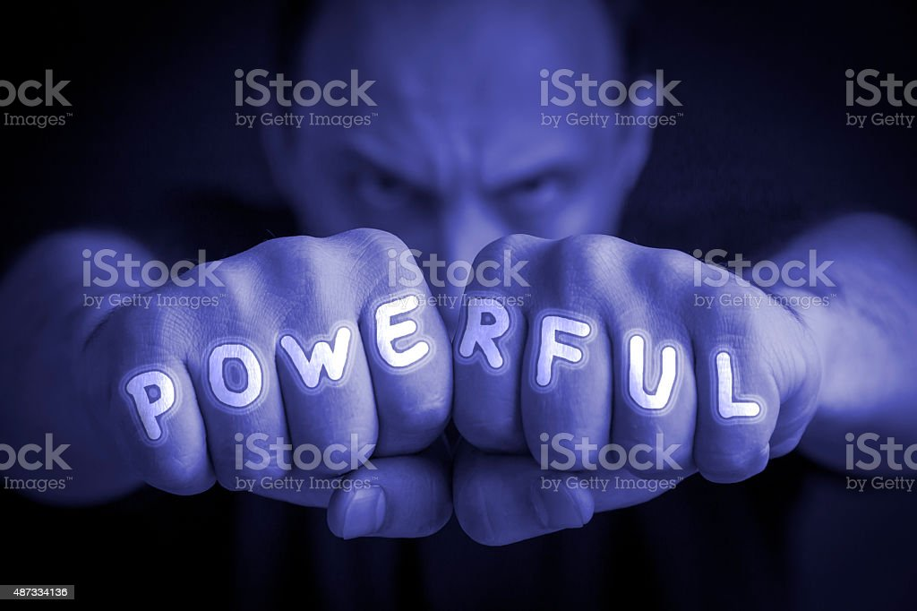POWERFUL written on an angry man fists royalty-free stock photo
