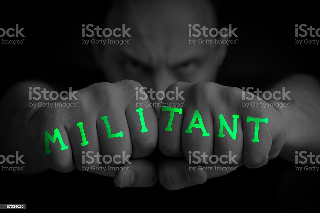 MILITANT written on an angry man fists royalty-free stock photo