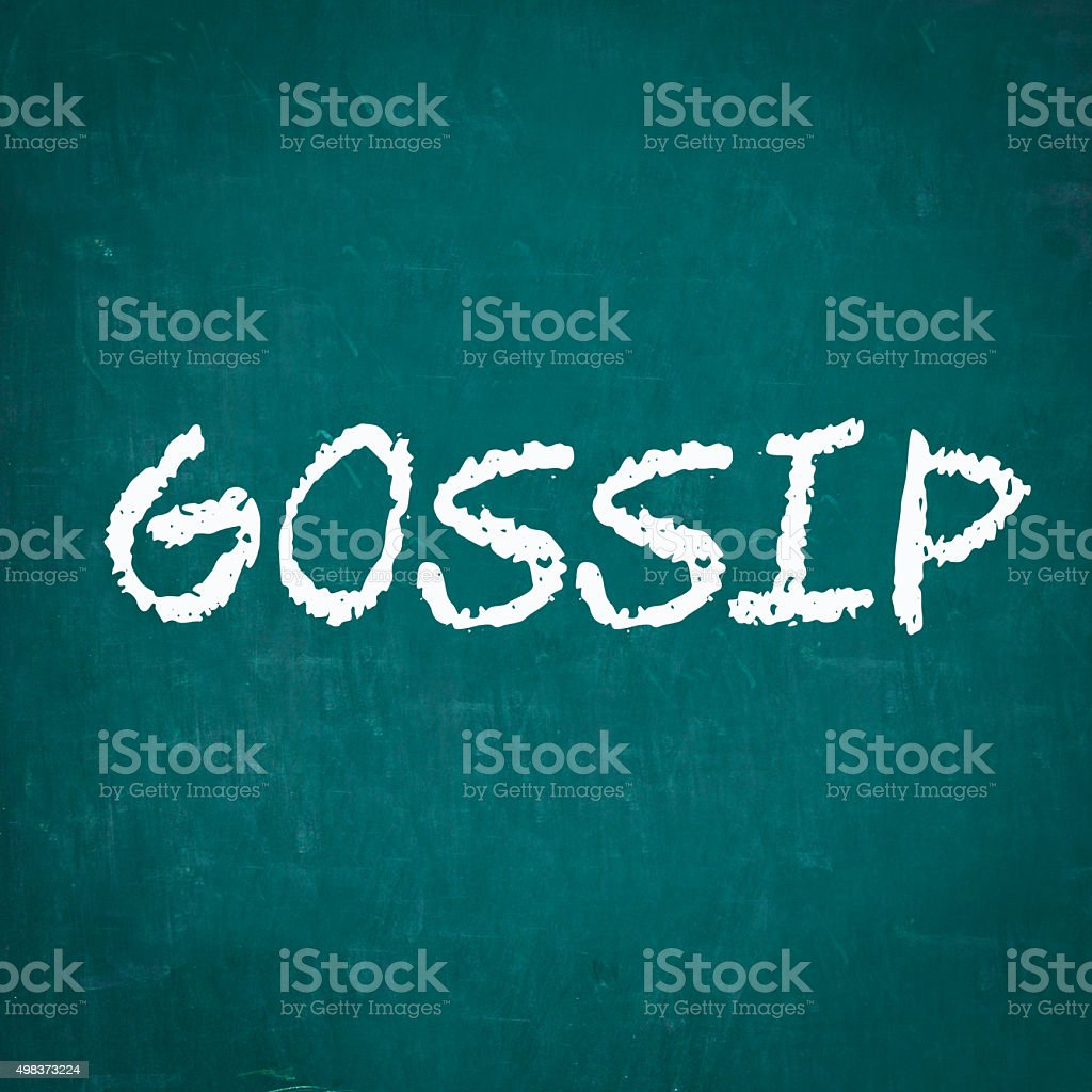 GOSSIP written on chalkboard stock photo