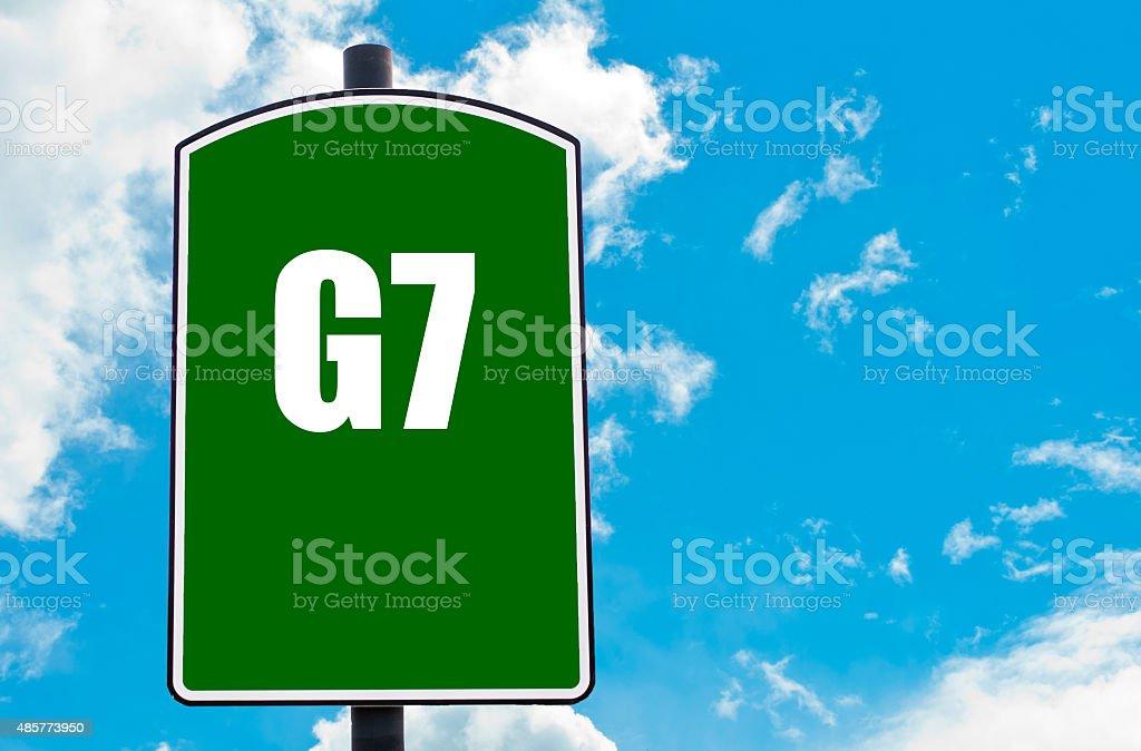 G7 SUMMIT written on green road sign stock photo