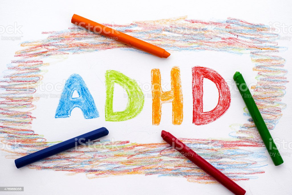 ADHD written on sheet of paper stock photo