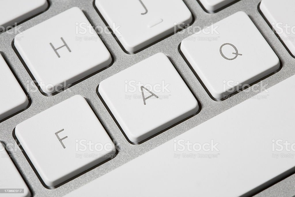 FAQ written on sliver and white computer keyboard royalty-free stock photo