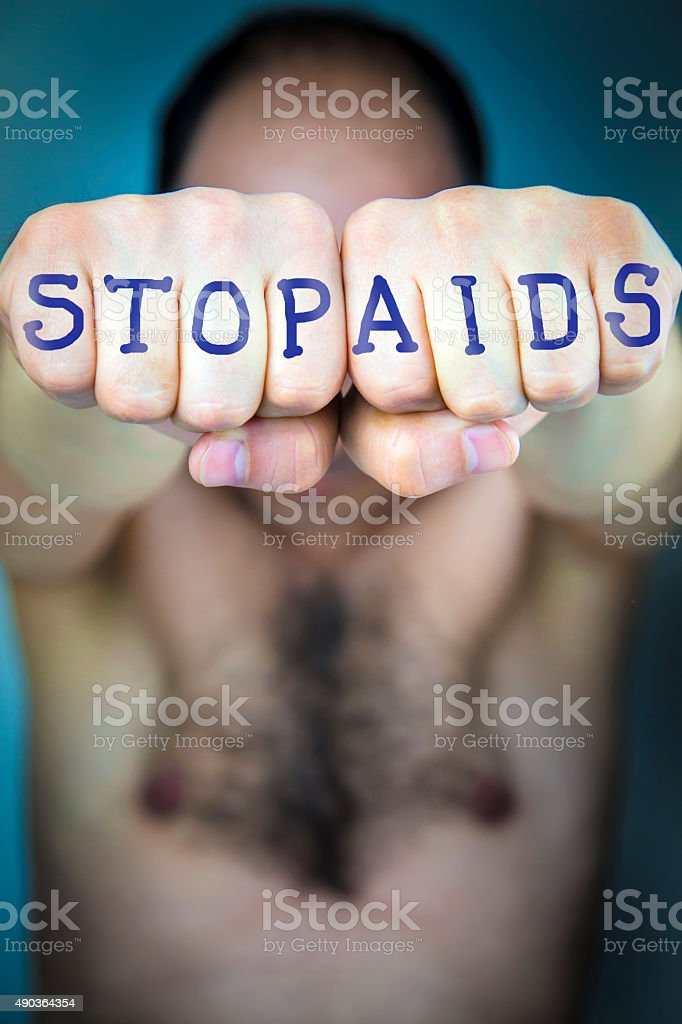 STOP AIDS written on the fists of a man stock photo