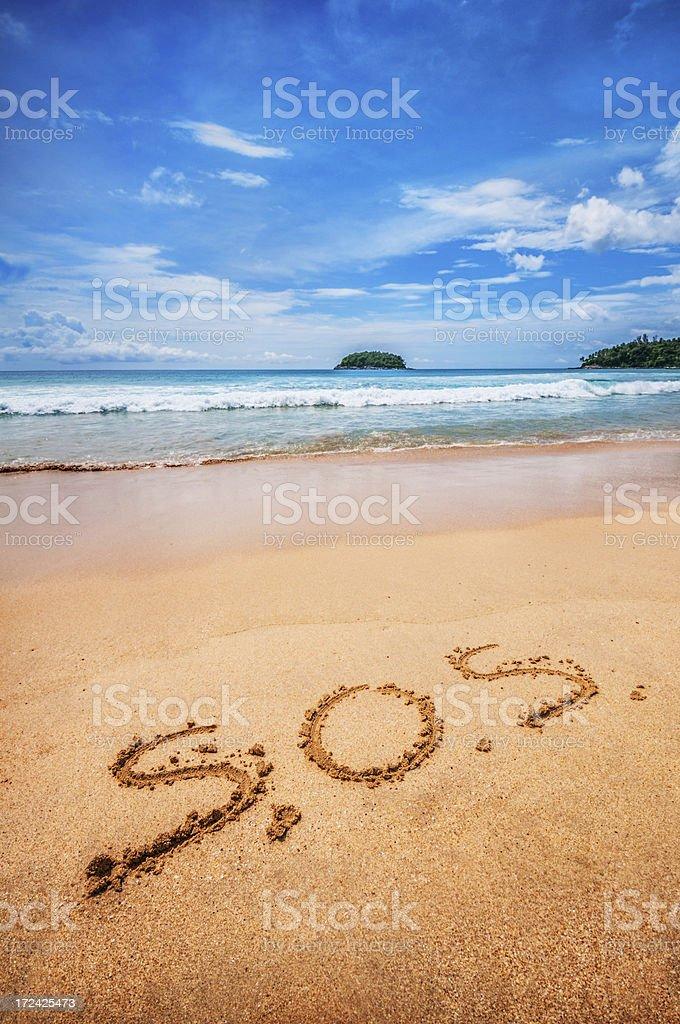 SOS Written on the Sand stock photo