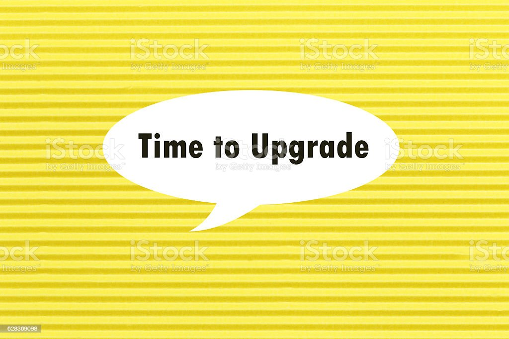 TIME TO UPGRADE written under torn paper. stock photo