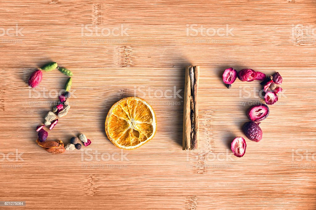 2017 written with spices on wooden background, food 2017 stock photo