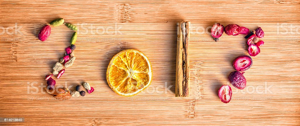 2017 written with spices on wooden background, new year concept stock photo