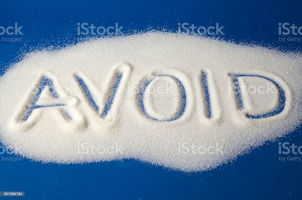 AVOID written with sugar royalty-free stock photo