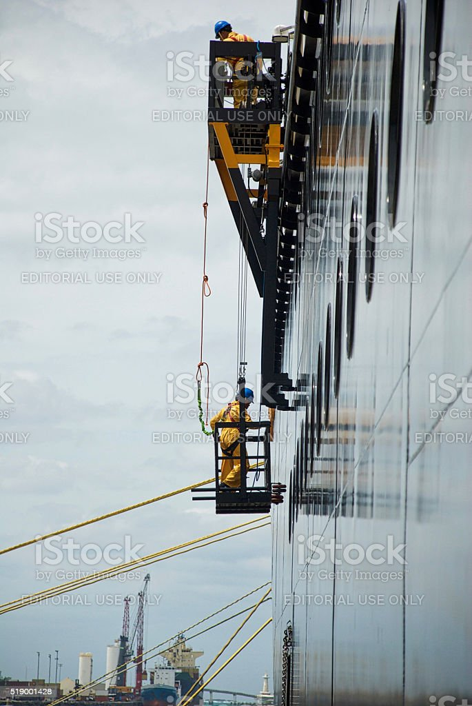 Wrokers Clean Cruise Ship, Close-up stock photo