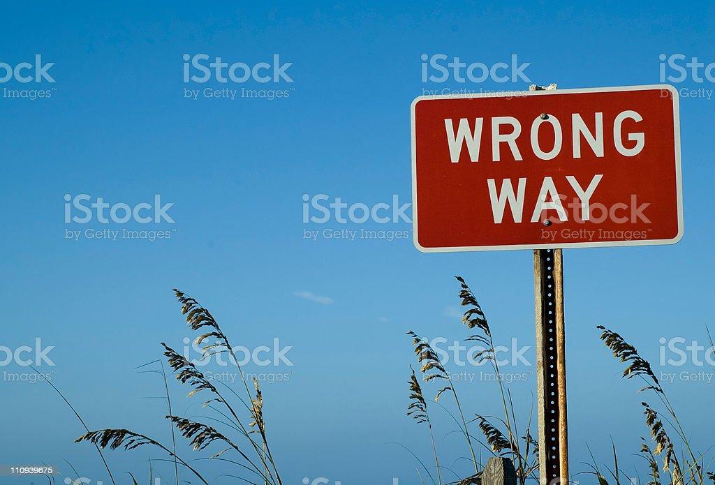 Wrong Way Sign at Beach stock photo