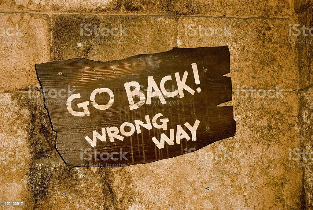 wrong way sign stock photo