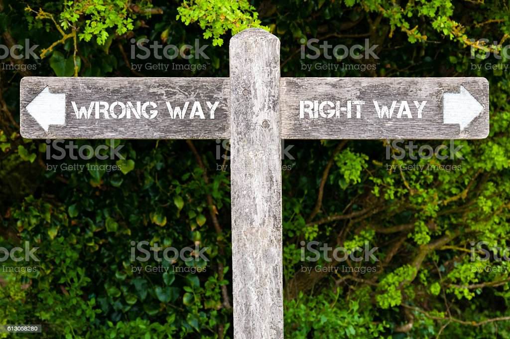 Wrong Way versus Right Way directional signs stock photo