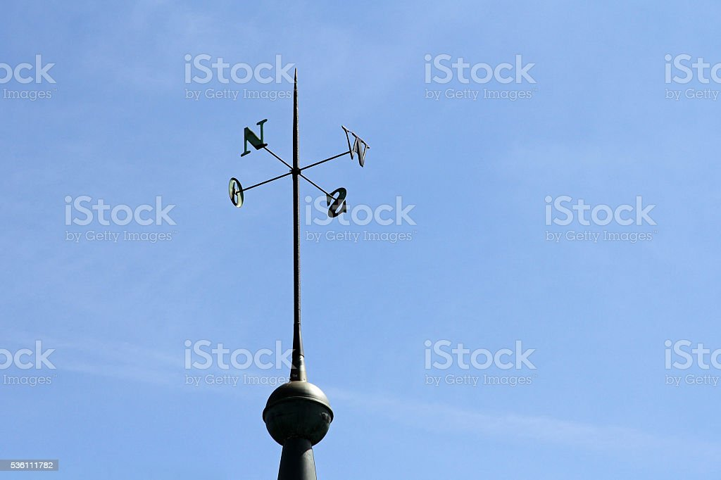 Wrought iron display of directions on a tower stock photo