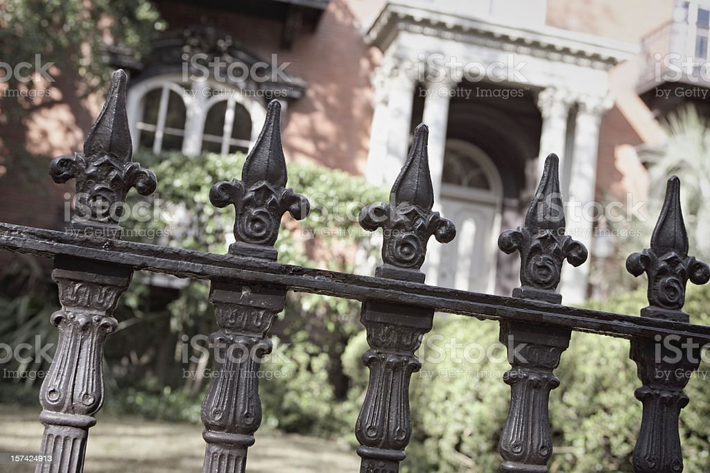 Wrought iron fence close-up outside a nice house stock photo