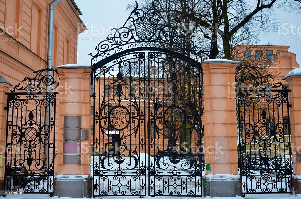 Wrought iron gate in a noble house stock photo