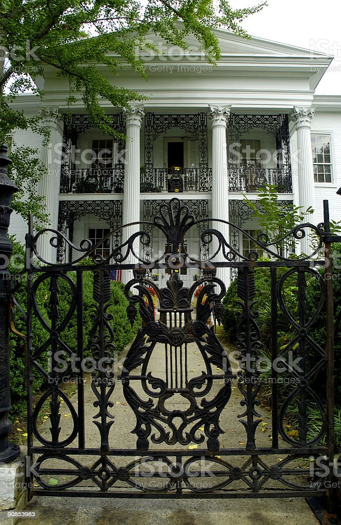 wrought iron gate view to a mansion royalty-free stock photo