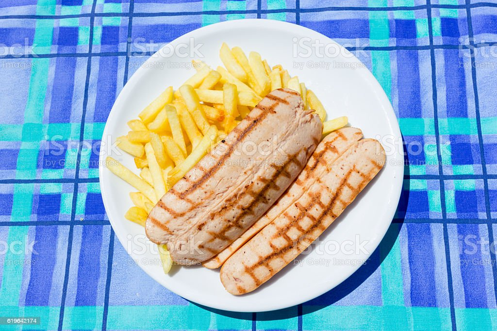 Wurstell with potato chips stock photo