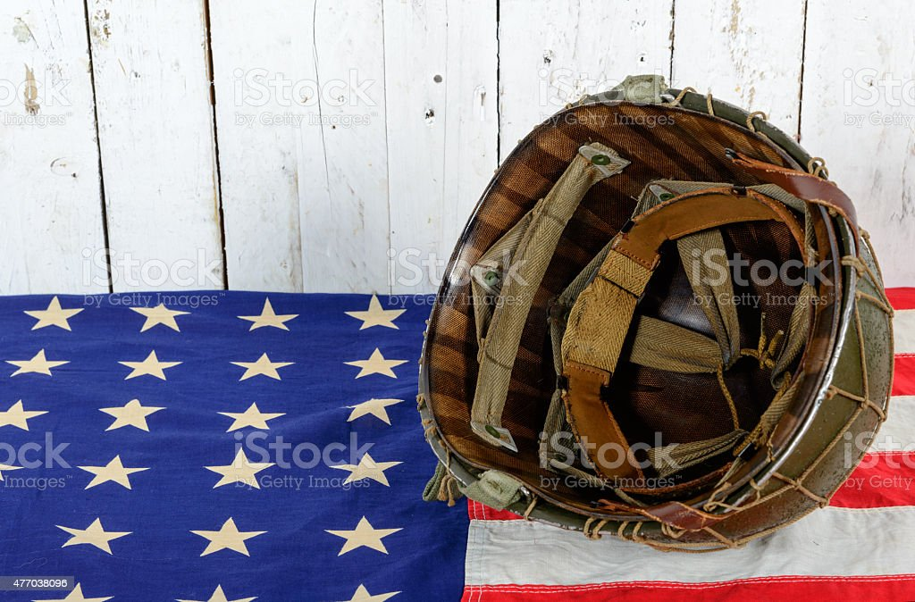 wwii helmet on american flag stock photo