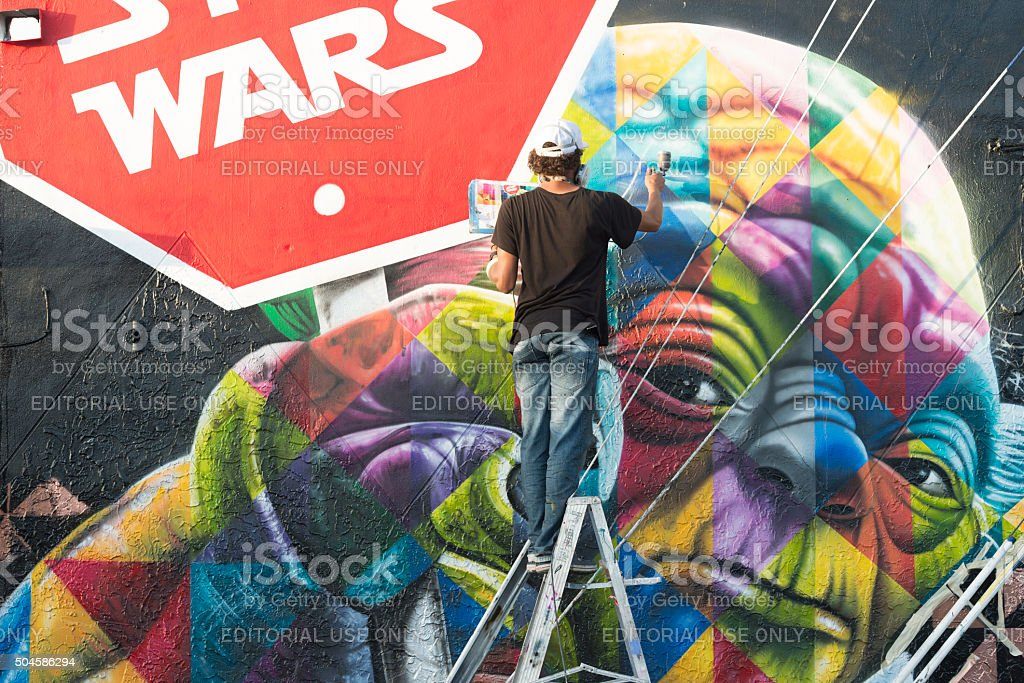 Wynwood Miami Graffiti Artist Spray Painting Colorful Mural stock photo