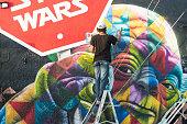 Wynwood Miami Graffiti Artist Spray Painting Colorful Mural