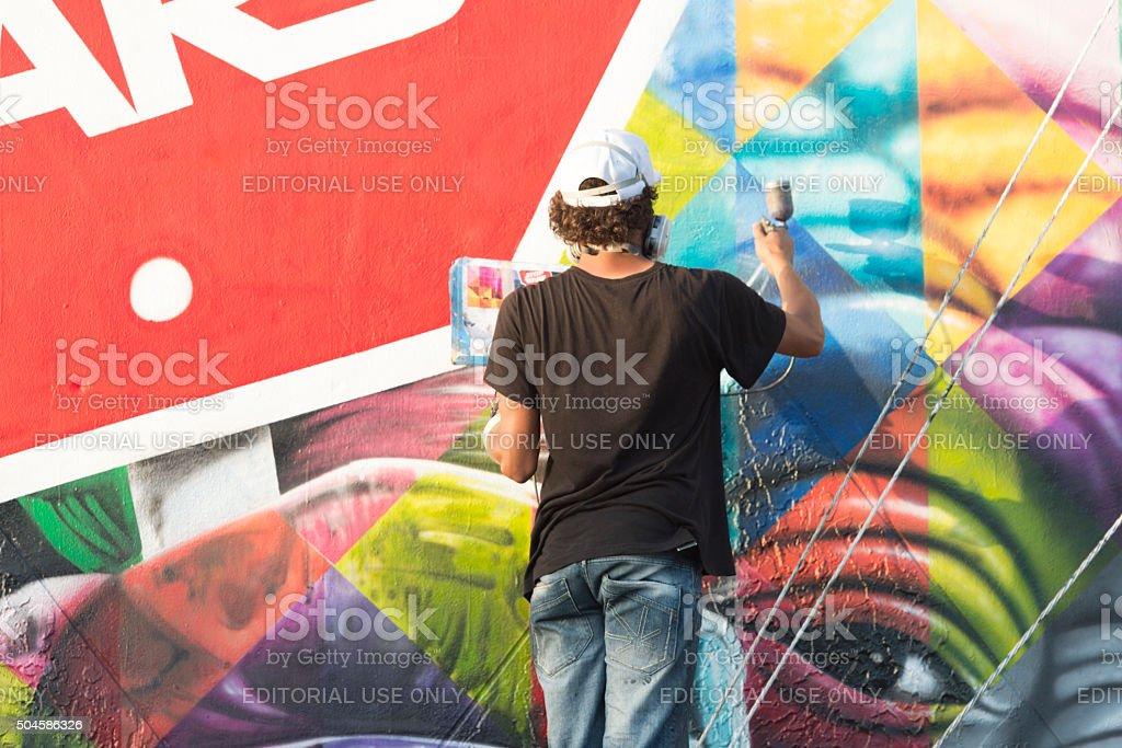 Wynwood Miami Graffiti Artist Spray Painting Colorful Mural stock photo