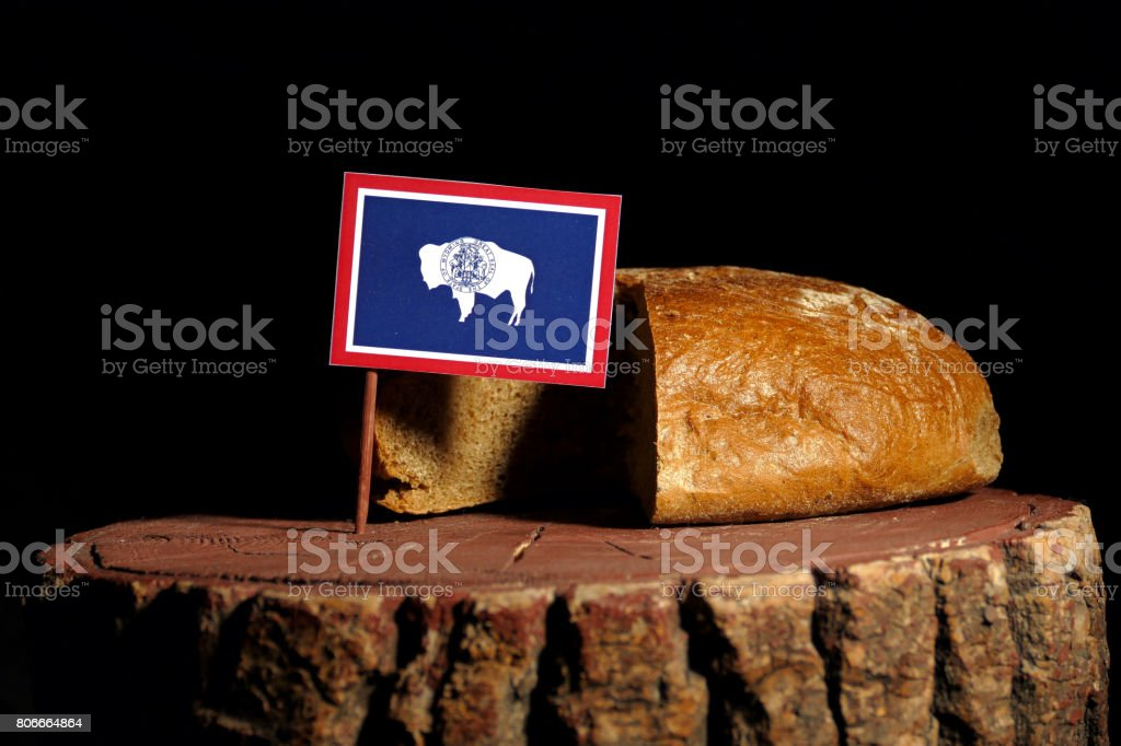 Wyoming flag on a stump with bread isolated stock photo