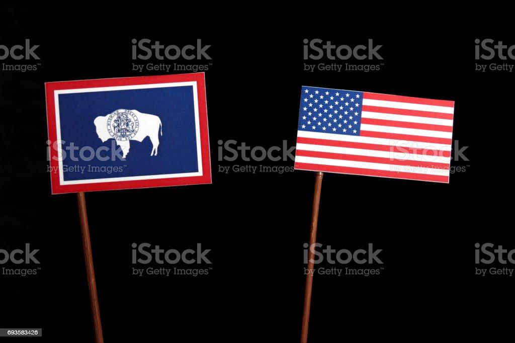 Wyoming flag with USA flag isolated on black background stock photo