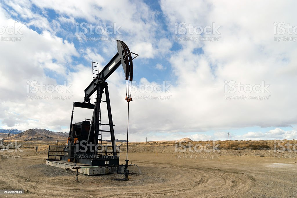 Wyoming Industrial Oil Pump Jack Fracking Crude Extraction Machine stock photo