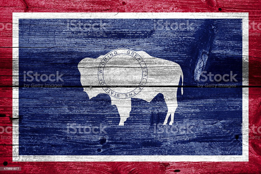 Wyoming State Flag painted on old wood plank texture royalty-free stock photo