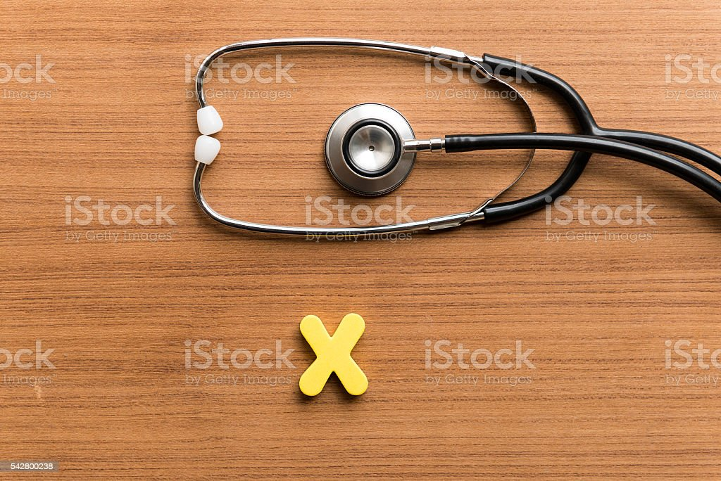 x colorful word with stethoscope stock photo