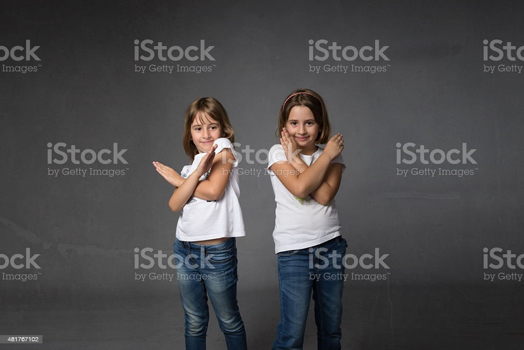 x letter gestured with hands crossed stock photo
