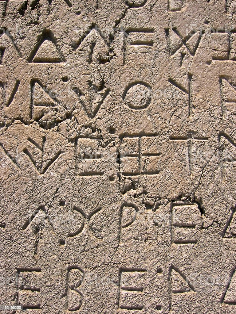 xanthos letters carved in stone background stock photo
