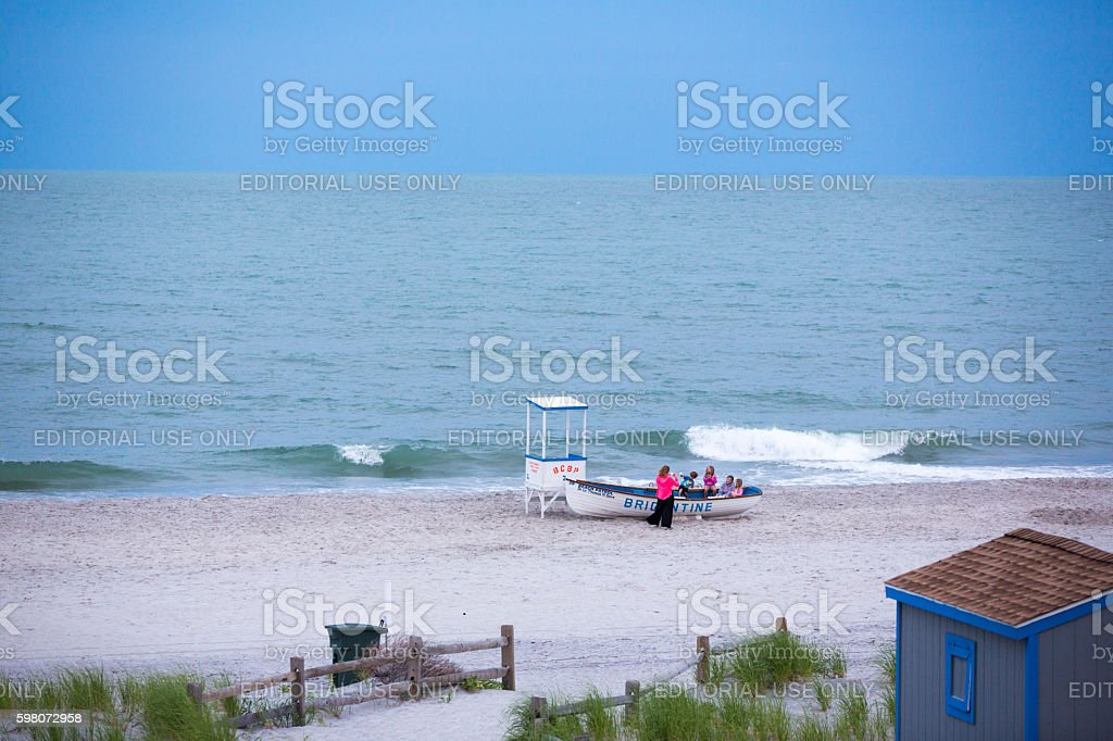 XFamily taking pictures on deserted Brigantine Beach in New Jersey stock photo