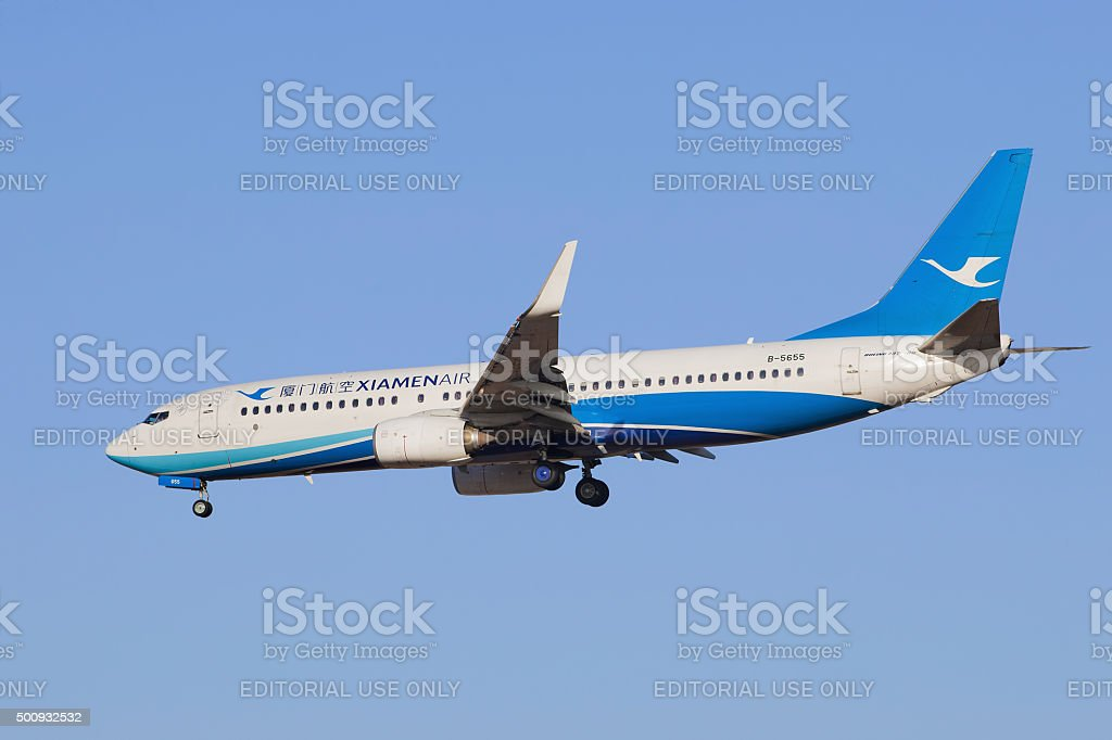 Xiamen Airlines B-5655 Boeing 737-800 landing at Beijing Airport. stock photo