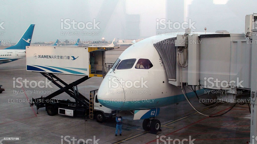 Xiamen Airlines Ground Crew Waiting To Unload Landed Airplane.China stock photo